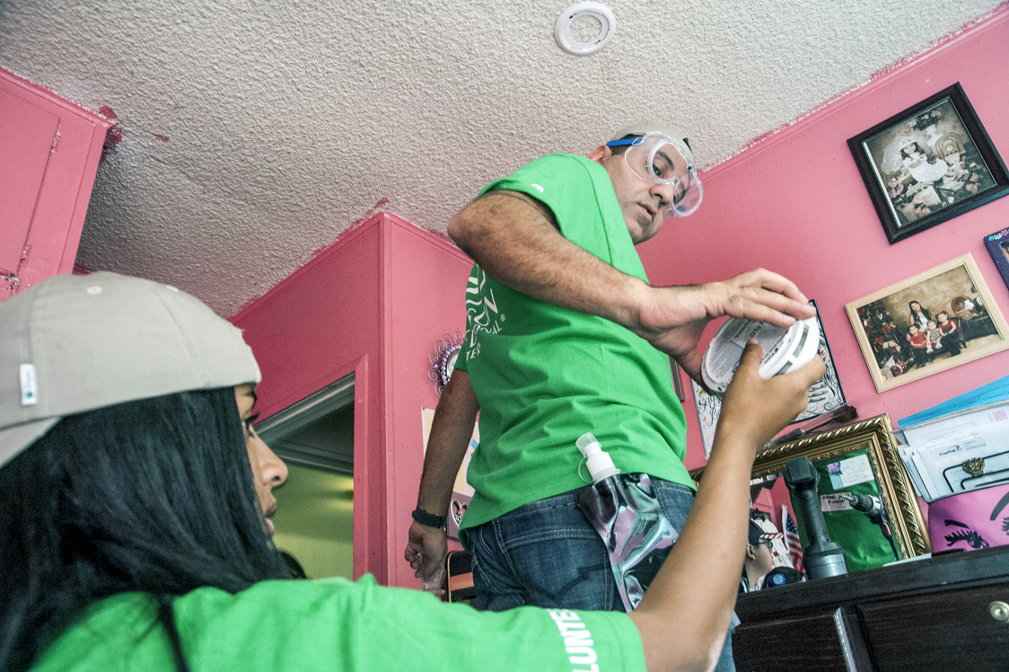 Edison Volunteers Help Install Smoke Detectors 3bl Media Wiring A Detector Jacqueline Hanna Left Hands Her Dad Fady New Alarm To In An El Monte Home