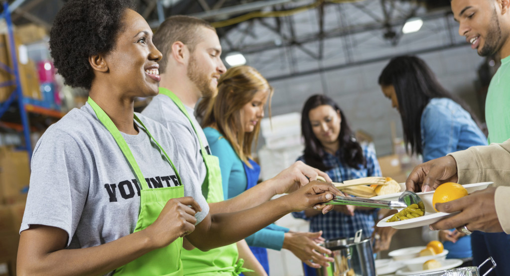 people serving food to others
